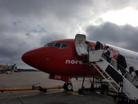Hurtigrute, Flug mit Norwegian
