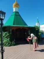 Russische Frau beim beten